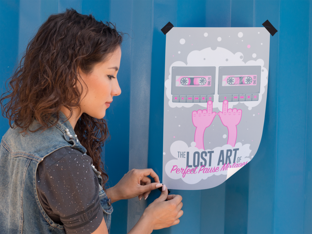 Woman taping poster to wall